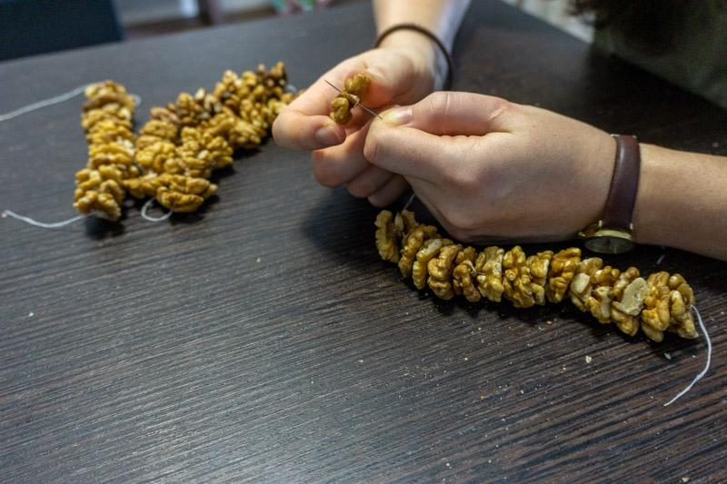 Stringing the walnuts