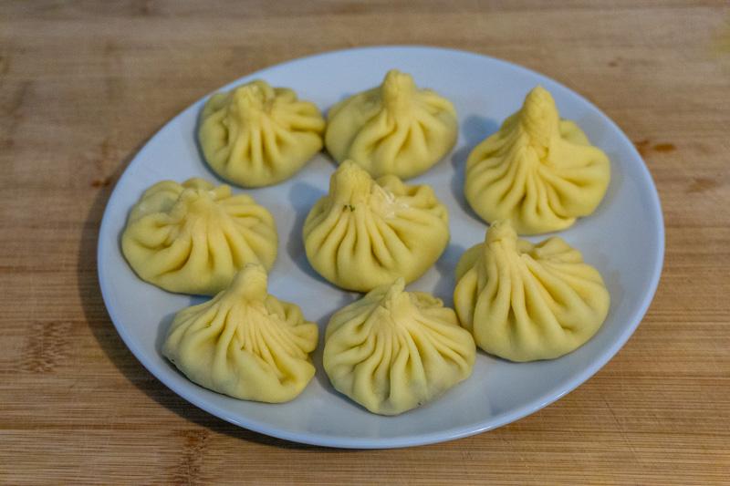 Raw khinkali ready to be boiled