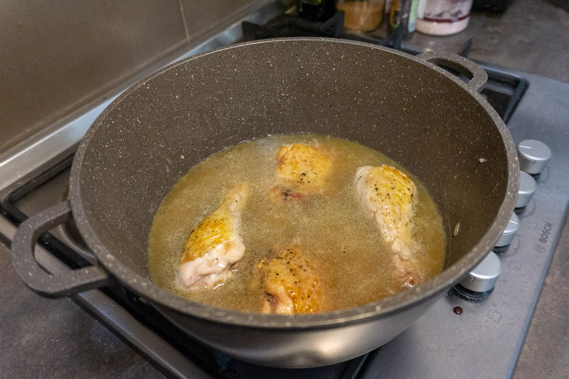 Adding the chicken stock