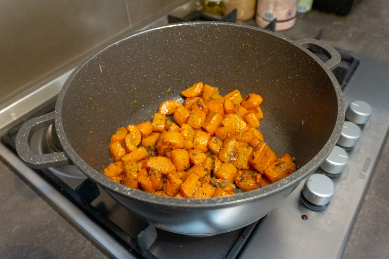 Cooking the carrots in the spice mixture