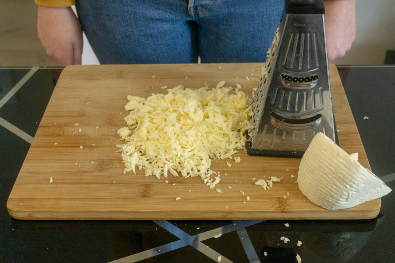 Grating the cheese for khachapuri