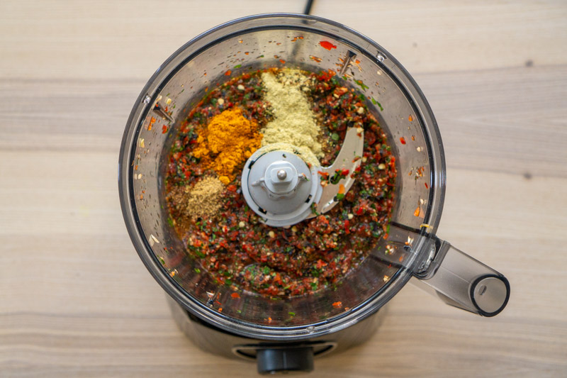Adding the spices to your adjika paste